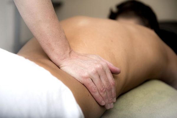Man getting treatment from a chiropractor in Castle Hill