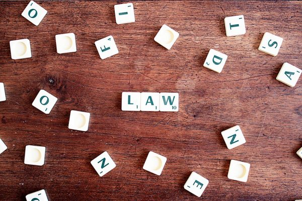 scrabble tiles spelling the word law