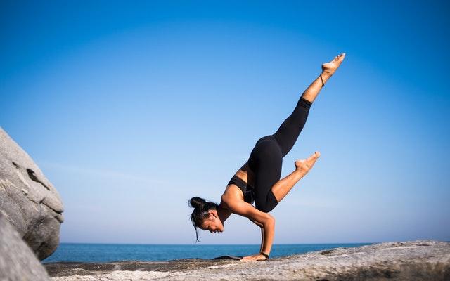 Woman doing a yoga hand stand