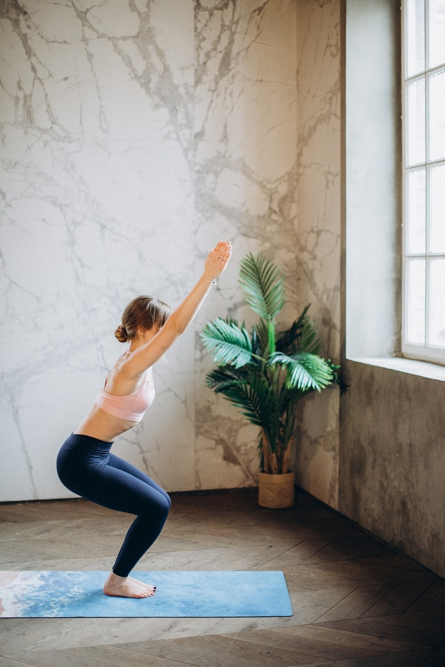 Woman taking the best online yoga courses