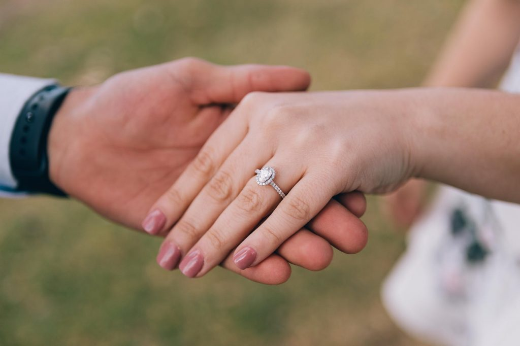 Couple showing the woman's diamond ring made in Melbourne