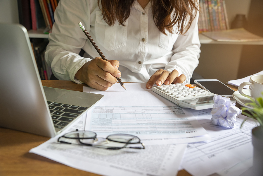Accountant calculating company's annual tax
